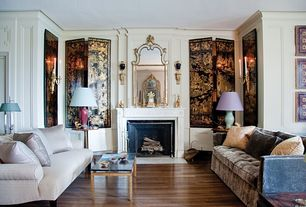 Traditional Living Room with Crown molding, Wall sconce, Hardwood floors, Cement fireplace