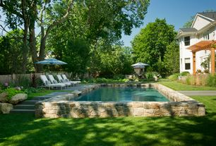 Traditional Swimming Pool with Fence, Pathway, Outdoor kitchen, double-hung window, Lap pool, Trellis, exterior stone floors
