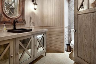 Eclectic Powder Room with Glass panel, limestone floors, Wainscotting, Whitewashed Wainscoting, specialty door, Flush