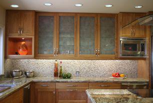 Modern Kitchen with Kitchen island, KitchenCraft Frost Glass Cabinet Insert, Complex granite counters, Glass panel, Flush