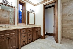 Craftsman Master Bathroom with Travertine counters, Flat panel cabinets, Crown molding, Master bathroom, flush light