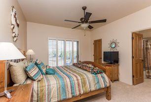 Mediterranean Guest Bedroom with Standard height, specialty door, Ceiling fan, Carpet