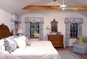 Traditional Guest Bedroom with Ceiling fan, Hardwood floors