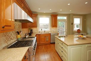 Traditional Kitchen with Undermount sink, Glass panel door, Hardwood floors, Breakfast nook, Large Ceramic Tile, L-shaped