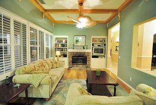 Tropical Living Room with Built-in bookshelf, Hampton Bay Havana 48 in. Outdoor Natural Iron Ceiling Fan, flush light