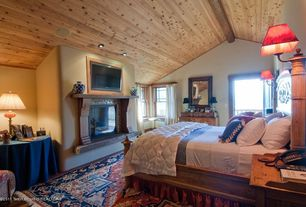 Rustic Master Bedroom with metal fireplace, Hardwood floors, Cathedral ceiling, Wall sconce, Carpet, flush light