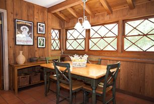 Craftsman Dining Room with Chair rail, Standard height, Exposed beam, terracotta tile floors, specialty window, Wainscotting