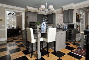 Traditional Kitchen with Breakfast bar, Painted Hardwood Oak Flooring, Raised panel, Canyon Creek Stratford Cabinets, Flush