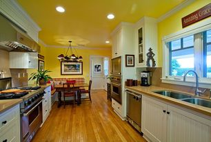 Traditional Kitchen with Flat panel cabinets, gas range, can lights, Bamboo floors, Standard height, Undermount sink