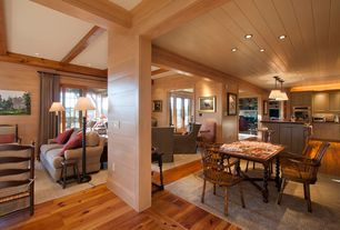 "Country Great Room with 18"" bar stool w/ turned leg, Built-in bookshelf, French doors, Hardwood floors, Exposed beam"