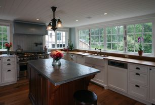 Craftsman Kitchen with Wood counters, Dynasty hardware - shaker style cabinet pull, Large Ceramic Tile, Flat panel cabinets
