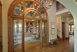 Traditional Hallway with Hardwood floors, French doors, Arched window, Chandelier, High ceiling, Loft