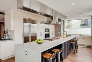 Modern Kitchen with Island Hood, Sub-Zero French door refrigerator, picture window, Breakfast bar, Apron front sink, Paint