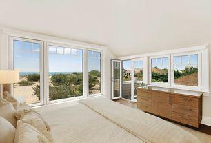 Modern Master Bedroom with French doors, Grand matelasse coverlet-ivory, Laminate floors, Built-in bookshelf