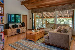 Modern Living Room with Hardwood floors, Upton Home Ridge Trunk Coffee/ Cocktail Table, Sunken living room, Exposed beam