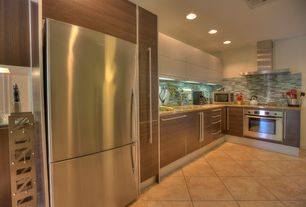 Contemporary Kitchen with can lights, Simple granite counters, Ceramic Tile, L-shaped, Flush, limestone tile floors