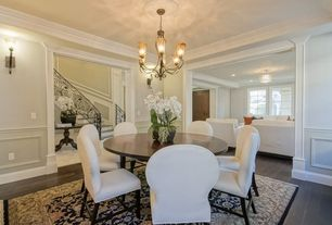 Traditional Dining Room with Chandelier, Crown molding, Wall sconce, Hardwood floors, Wainscotting