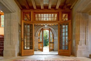 Craftsman Entryway with Custom glass doors roman style iron round double doors, French doors, limestone tile floors