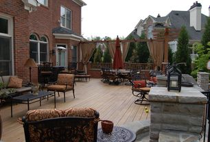 Traditional Patio with Fence, exterior stone floors, Trellis, Deck Railing, Transom window, French doors, double-hung window