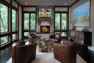 Contemporary Living Room with Hardwood floors, stone fireplace, Crate and barrel driftwood coffee table