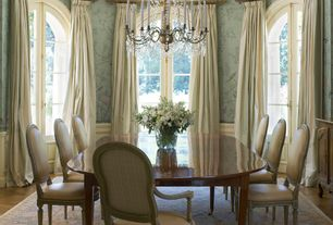 Traditional Dining Room with Chandelier, Wainscotting, interior wallpaper, Arched window, Crown molding, Hardwood floors
