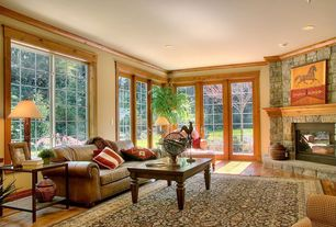 Craftsman Living Room with stone fireplace, Casement, French doors, can lights, Crown molding, Standard height, Fireplace