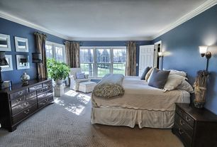 Traditional Master Bedroom with Wall sconce, Crown molding, six panel door, double-hung window, Carpet, Standard height