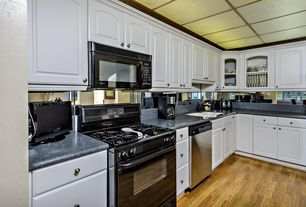 Traditional Kitchen with Simple granite counters, gas range, Simple Granite, Undermount sink, L-shaped, partial backsplash