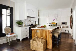 Eclectic Kitchen with Undermount sink, Complex marble counters, Flat panel cabinets, Glass bell pendant light, Kitchen island