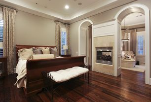 Traditional Master Bedroom with Curved doorways, Hardwood floors, Montage galleries 4736 round tufted ottoman
