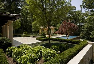 Mediterranean Landscape/Yard with Gazebo, exterior stone floors, Raised beds