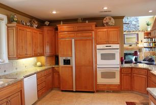 Traditional Kitchen with stone tile floors, Undermount sink, Raised panel, Crown molding, Stone Tile, U-shaped, Casement