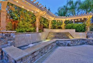 Traditional Landscape/Yard with Fence, exterior tile floors, Trellis, Fountain