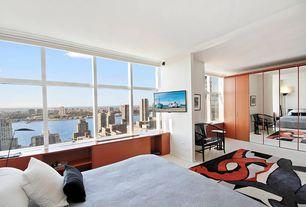 Contemporary Master Bedroom with Carpet, Built-in bookshelf, sliding glass door, Standard height, picture window