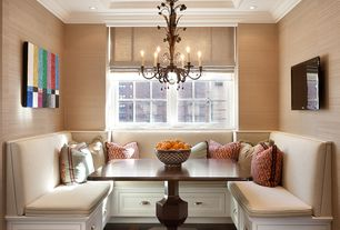 Contemporary Dining Room with Chandelier, Crown molding, Hardwood floors, Window seat, interior wallpaper, can lights