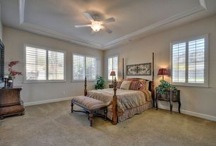 Traditional Master Bedroom with Arched window, Crown molding, Standard height, Ceiling fan, Carpet