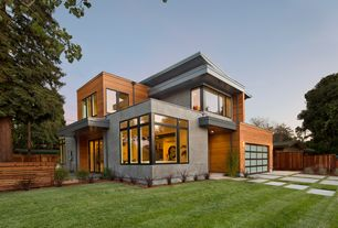 Contemporary Exterior of Home with Exposed concrete, Cedar siding, Glass garage door