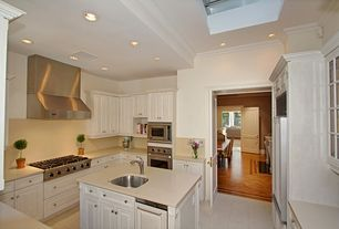 Traditional Kitchen with Crown molding, High ceiling, Wall Hood, electric cooktop, Galley, Travertine counters, Travertine