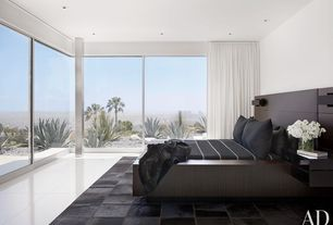 Modern Master Bedroom with picture window, Concrete tile , can lights, Steel column, Standard height, Paint, Natural light