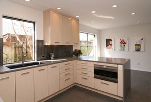 Contemporary Kitchen with Standard height, Glass Tile, European Cabinets, full backsplash, Flush, U-shaped, Corian counters