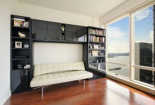 Contemporary Living Room with picture window, Built-in bookshelf, Laminate floors, Standard height