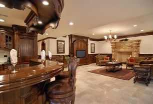 Traditional Living Room with Standard height, Fireplace, Concrete tile , Wainscotting, can lights, Crown molding, Chandelier
