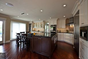 Traditional Kitchen with Standard height, Stone Tile, Wine refrigerator, Paint, Flat panel cabinets, Wall Hood, U-shaped