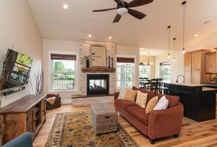 Country Great Room with Built-in bookshelf, stone fireplace, Ceiling fan, Pendant light, Standard height, Hardwood floors