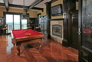 Traditional Game Room with brick fireplace, French doors, Chandelier, Louvered door, Box ceiling, Laminate floors, Fireplace