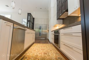 Contemporary Kitchen with Flat panel cabinets, Crown molding, Soapstone, Built In Refrigerator, Soapstone counters, wall oven
