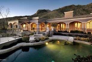 Mediterranean Exterior of Home with Lion set statues, Custom grecian style pool