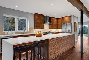 Contemporary Kitchen with Kitchen island, Destiny: slab cabinets, Wall Hood, Casement, Paint 1, Undermount sink, can lights