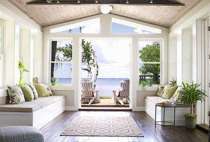 Cottage Living Room with Pendant light, Window seat, Hardwood floors, Standard height, double-hung window