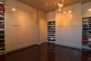 Contemporary Closet with Built-in bookshelf, Laminate floors, Chandelier